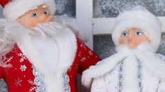 Miniature toy Santa Claus and Snow Maiden with present box Stock Footage