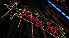 Neon Sign FROHES FEST on Big Wheel - Northern Germany Stock Footage