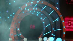 Round gate on stage with part of screen, flashing illumination Stock Footage