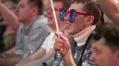 Boy in glasses sing among people at concert of Legend RetroFM Stock Footage