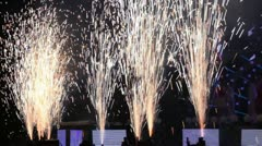 Fireworks near stage during concert show in dark hall Stock Footage