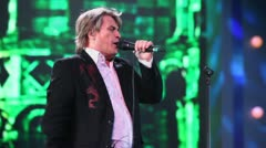 Aleksey Glizin sings on stage during concert of Legend RetroFM Stock Footage
