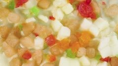Pieces of different fruits on pie circling closeup Stock Footage