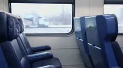 Few empty chairs at window at passengers train wagon Stock Footage