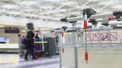 Chain on luggage cart in airport with passengers at reception Stock Footage