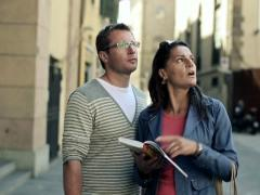 Tourist couple reading guide in the city, steadicam shot NTSC Stock Footage