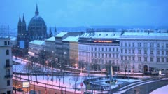 Traffic on Europe square in Vienna at winter evening - stock footage
