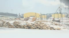 Wood factory near hills at winter, view from train in motion Stock Footage