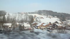 Many houses at village near forest, view from train in motion Stock Footage