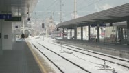 Train ride away from railway station at winter day in village Stock Footage
