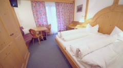 Hotel bedroom with beds and other furniture, panoramic motion Stock Footage