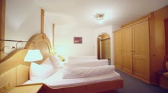 Hotel apartament with beds and other furniture, panoramic motion Stock Footage