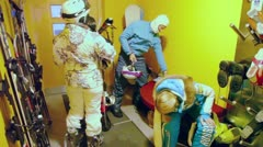 Four riders prepares to ride skiing room with lot of equipment Stock Footage