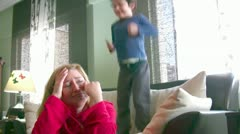 Noisy energetic little boy and tired mom - stock footage