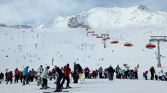 Crowd of riders in Alps near cableway at sunny winter day - stock footage