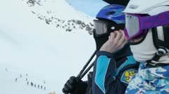 Rider speaks by cellphone then he ride on ropeway with friend Stock Footage
