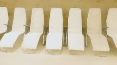 Row of white comfortable seats in empty light room for waiting - stock footage