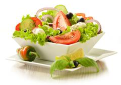 vegetable salad bowl isolated on white isolated on white - stock photo