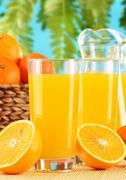 composition with two glasses of orange juice and fruits - stock photo