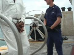 Coast Guard offloading drug smugglers from Cutter - stock footage