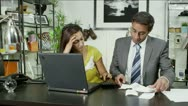 Man and woman looking at their personal accounts and paying the bills Stock Footage