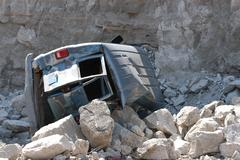 Van aftermath after falling off Cliff - stock photo