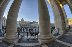 giant columns of piazza san pietro - st peter square in rome - stock photo