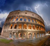 Beautiful dramatic sky over colosseum in rome Stock Photos