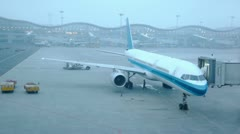 Several aircrafts stand near airport terminals at morning Stock Footage