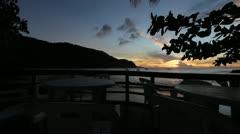 Outdoor restaurant on beach at sunset (HD) k Stock Footage