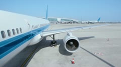 Aircraft stand at airport field with working turbine Stock Footage