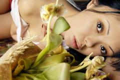 Sensual woman and flowers Stock Photos