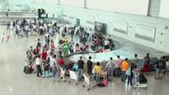 Stock Video Footage of Passengers wait for baggage near conveying machine in airport