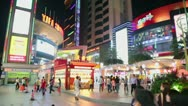 Many of people walk by street with shops, panoramic motion Stock Footage