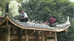 Chinese workers are being built of traditional Chinese architecture - Pavilion Stock Footage