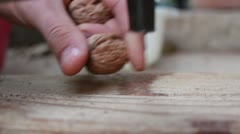 Cracking nuts board Stock Footage