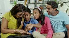 Happy family spending time together using a digital tablet - stock footage