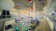 Customers walk around in multilevel mall, corner view Stock Footage