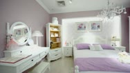 Females bedroom with many furniture and pink color wallpapers Stock Footage