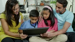 Happy family spending time together browsing the internet - stock footage