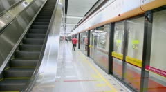 Train arrives at metro station near protection glass wall Stock Footage