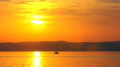 Beautiful sunset with horizon and boats Stock Footage