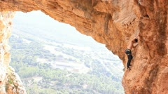 Rock climbing Mountain Climbing Extreme Sports rope cliff crag Motivation - stock footage