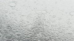Water pouring down on the window - stock footage