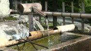 Water fountain made of wood and bamboo at the entrance of a Japanese temple Stock Footage