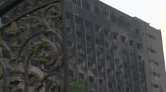 Damaged building in Cairo's Tahir Square as a result of arab spring uprising Stock Footage