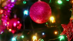 Colorful adornment with garland on fir tree, closeup view - stock footage
