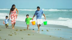 Hispanic parents playing with  kids on beach  - stock footage