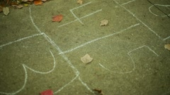 Hop scotch hopscotch street chalk 2 Stock Footage