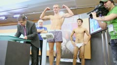 Weighing underwear boxer on press conference Stock Footage
